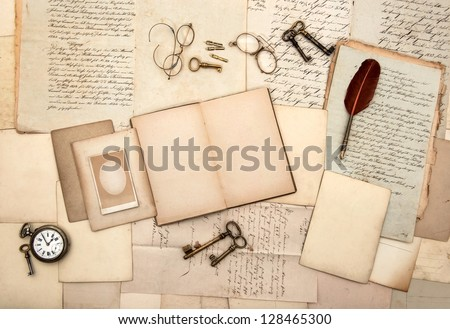 open book, vintage accessories, old letters, post cards, glasses, keys, clock. nostalgic background - stock photo