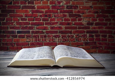 Open book ,wall old - stock photo