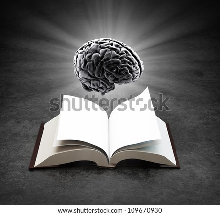 Open book with a glowing brain - knowledge and creativity concept - stock photo