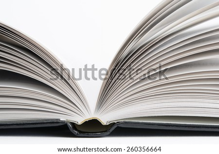 Open book with black hardcover isolated on white.