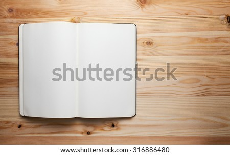 open book with blank pages on wood table,Notebook on wood table for background space for text - stock photo