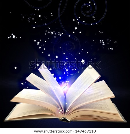 Open book with blue magic light and falling stars on  dark  background