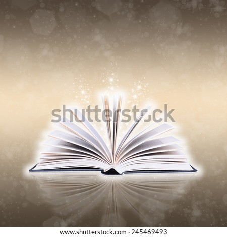 Open book with bokeh light and abstract background