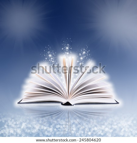 Open book with bokeh light and abstract background - stock photo