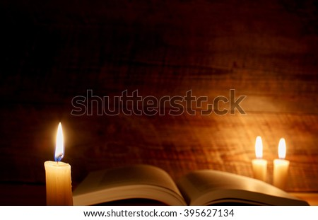 Open book with candlelight