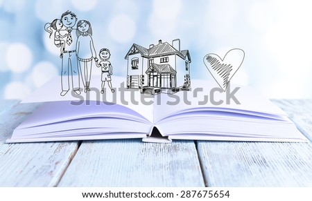 Open book with drawings on light background - stock photo