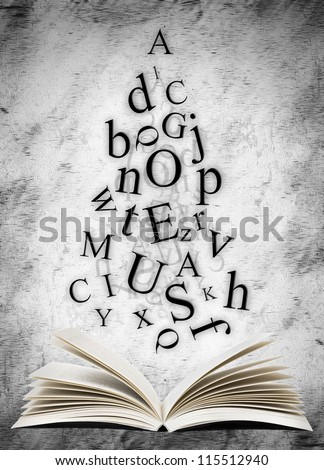 Open book with falling letters over grunge abstract background - stock photo
