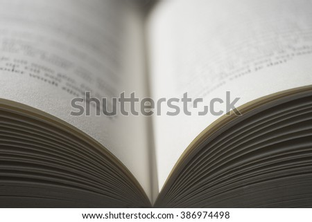 Open book with focus on foreground, swallow depth of field - stock photo