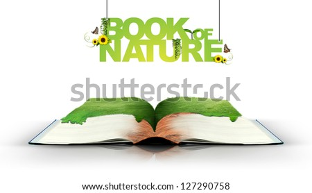 Open book with green nature - stock photo