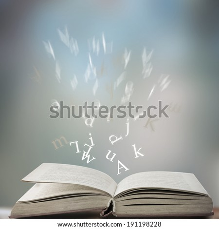 open book with letters - stock photo