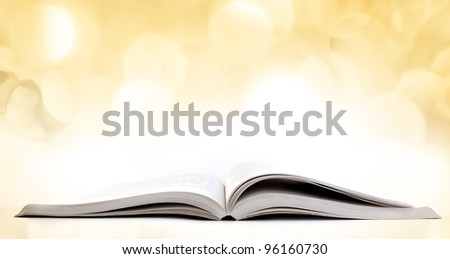 Open Book with lights in the background - stock photo