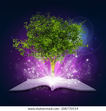 Open book with magical green tree and rays of light - stock photo