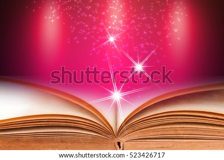 Open book with pink abstract background
