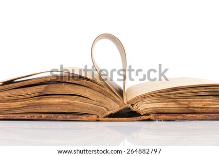 Open book with reflection isolated on white background