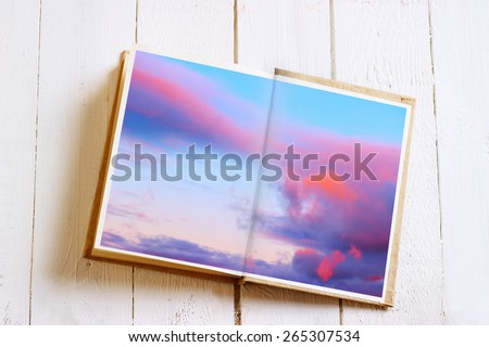 Open book with sky image. Multiple exposure effect was applied. - stock photo