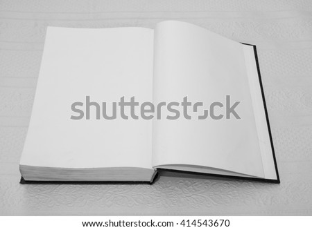 open book with white pages, white black picture - stock photo