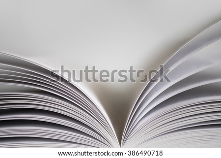 Open book with with shallow depth of field with white background