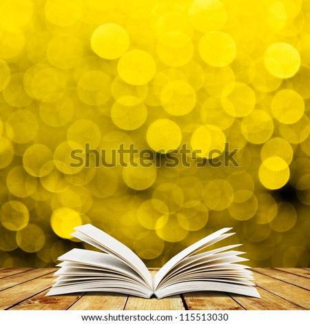 Open book wood planks over abstract bokeh background - stock photo