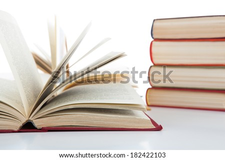 open books and stack of books on white background