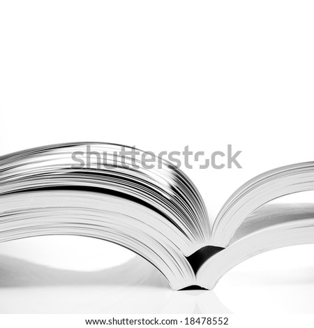 open books on white table