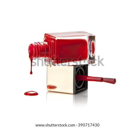 open bottle of red nail polish on a white background