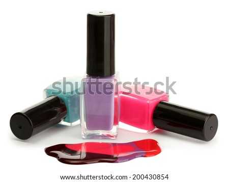 open bottles with bright nail polish isolated on white