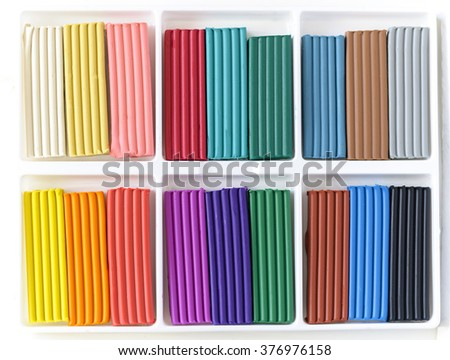 Open box with new set of cologful clay.  Multicolor clay blocks background - stock photo