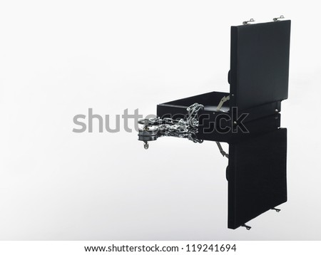 Open briefcase with padlock and chain over white background - stock photo