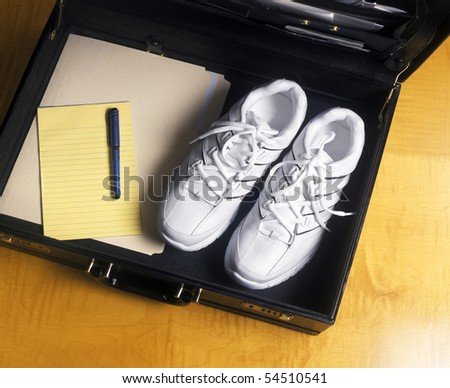 Open Briefcase with running shoes - stock photo