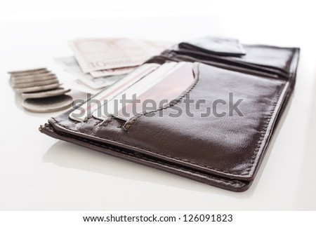 Open brown  wallet with money over white background