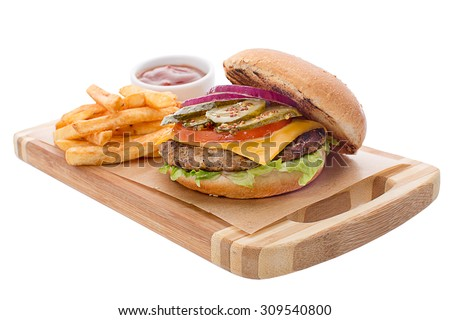 Open burger with cutlet, french fries, cheese, chopped pickles, tomatoes and cheese. Served on a wooden board with fries and ketchup in a gravy boat - stock photo