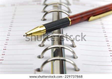 open calendar with pen ready for dates - stock photo