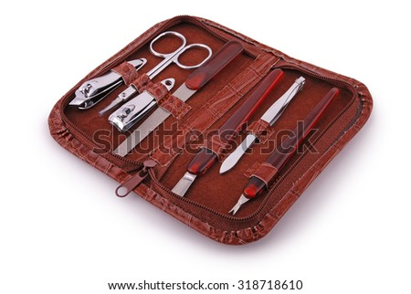 Open case with a manicure set isolated on white. Clipping path inside. - stock photo