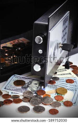 Open cell with money in safety deposit box - stock photo