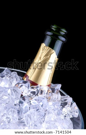 Open Champagne Bottle in Crystal Ice Bucket isolated over black