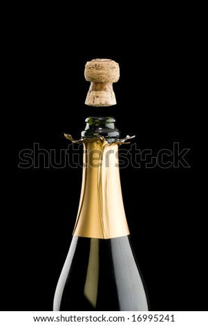 Open champagne bottle with floating cork - stock photo