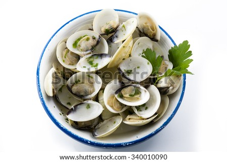 Open clams with parsley on blue napkin, isolated background - stock photo