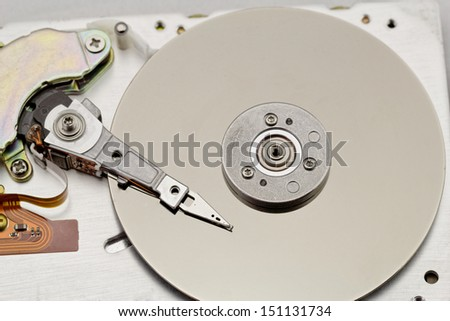 Open computer hard drive on white background with spezial color filter (HDD, Winchester)