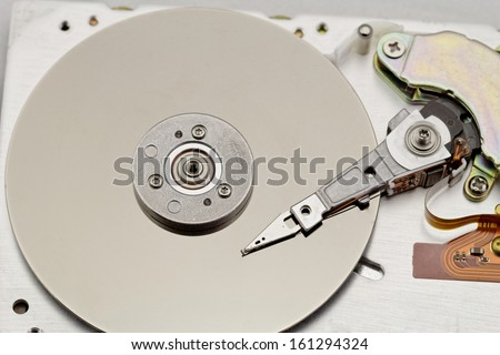 Open computer hard drive on white background with spezial color filter (HDD, Winchester) - stock photo