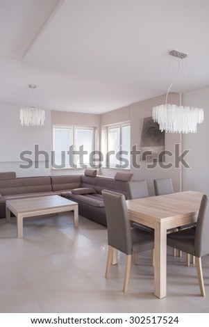 Open-concept living room with comfortable sofa and place for dining