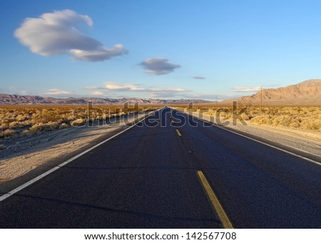 Open desert road: Death Valley National Park, just west of Death Valley Junction, heading toward Furnace Creek - stock photo