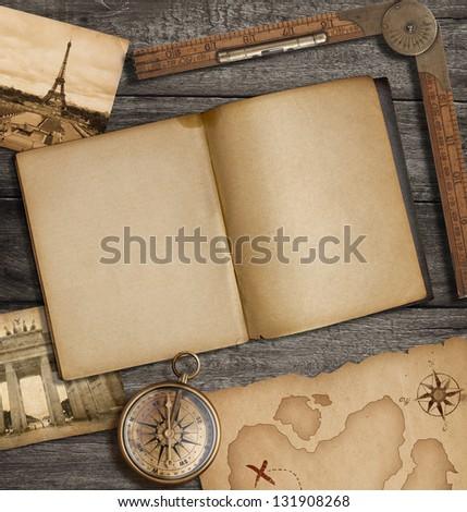 Open diary top view with old treasure map and compass - stock photo