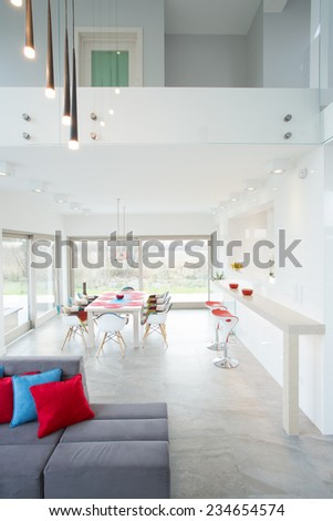 Open dining room and living room in modern house - stock photo