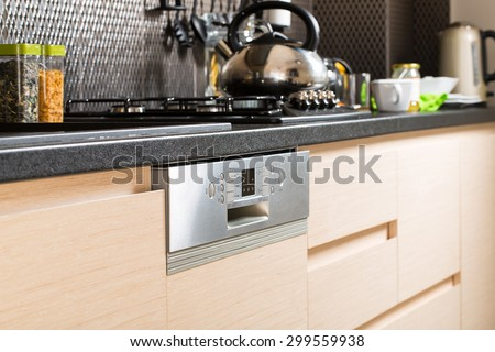 Open dishwasher with clean utensils in it. - stock photo