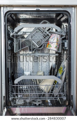 Open dishwasher with dirty utensils in it