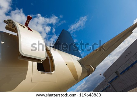open door and tail in private jet against the blue sky, Airport  flight schedule