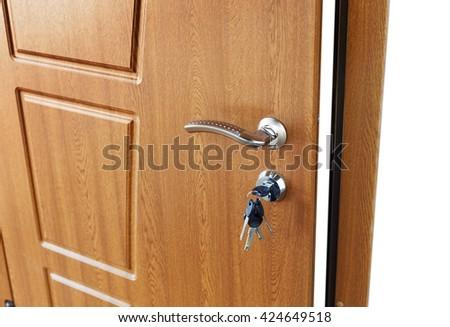 Open door handle wide angle. Door lock with keys. Brown wooden door closeup isolated. Modern interior design, door handle. New house concept. Real estate. - stock photo
