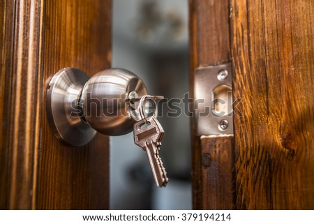 open door, knob and keyhole on wooden door, close up image. Natural material - stock photo