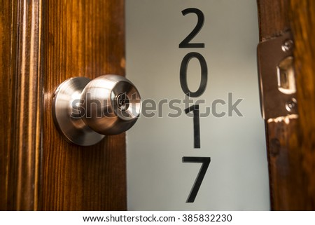 open door, knob and keyhole on wooden door, close up image. Natural material. Idea symbol of 2017 happy new year - stock photo