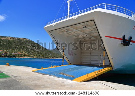 Open door of a ferry boat inside the harbor of Agia Marina, Greece